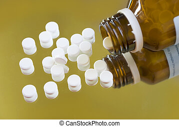 homeopathy schussler pills - homeopathic pills and a bottle...