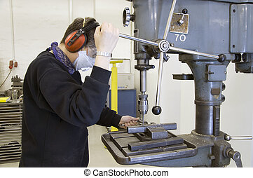 drilling machine and worker - metal worker with drilling...