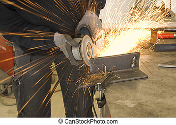 steel worker grinder - metal worker with grinder and a lot...