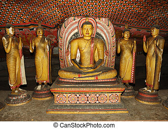 Buddha statues at Dambulla - buddhist cave temple complex in...