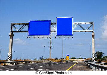 Blank RoadSign near the highway - A Blank Blue RoadSign...