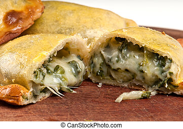 Spinach Empanada - Spinach empanada fill close up. The...