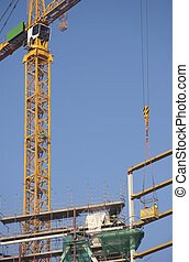 Tower crane hoisting workers - A tower crane is lifting...