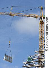 Tower crane hoisting a load