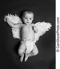 cute angel baby boy - portrait of a cute baby boy wearing...
