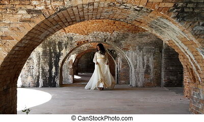 Bride Walking Under Brick Arches - Black woman in a 1960s...