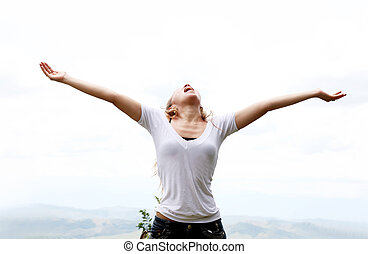 Freedom - Young woman with outstretched arms expressing...