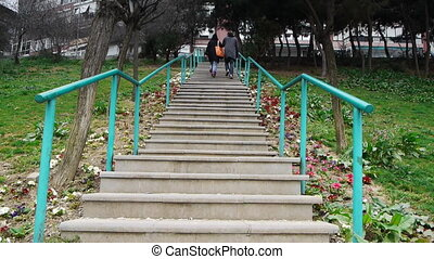 Stairs Focus defocus steps rails - Long concrete stairs with...