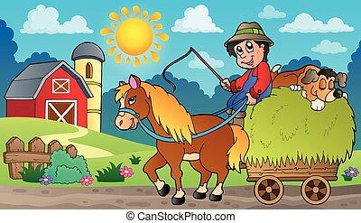 Hay cart with farmer near farm