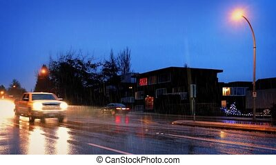 Cars Pass Houses In Heavy Rain - Traffic on highway near...