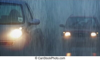 Cars In Mist And Rain - Vehicles passing in thick mist in...