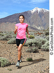 Cross-country trail runner - woman running - Running...