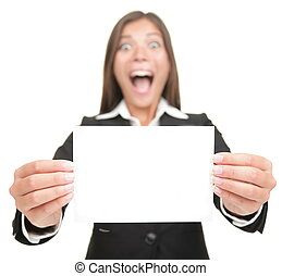 Business woman excited holding empty blank sign card -...