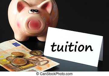 education tuition concept with piggy bank on black...