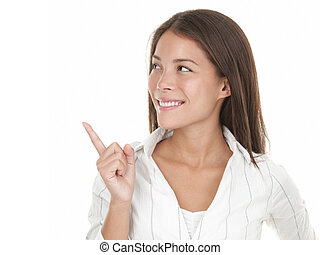 Woman looking and pointing at copy space - Pointing and...