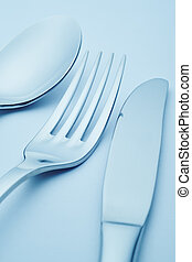 Knife, fork and spoon detail in blue tone. Cutlery