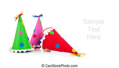 Polka-dot birthday hats on a white background