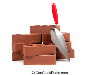 Bricks and a trowel on white - Red bricks and a masonry...