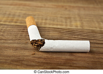 cigarette on a wooden table
