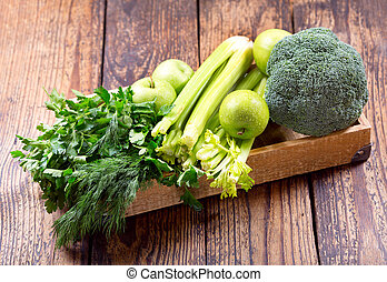 green fruit and vegetables in a wooden box