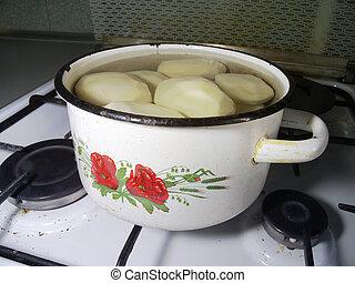 pan of potatoes on the gas stove