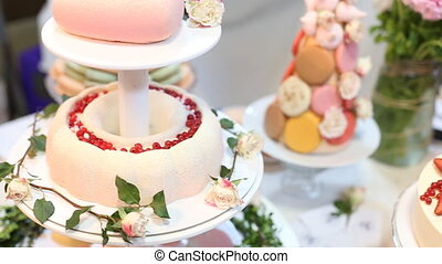 Tilt up of a beautiful wedding cake.