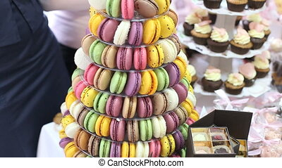 Colorful cookies with cream on table - Colorful cookies with...