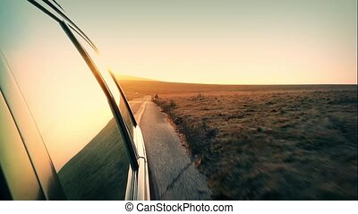 Driving Over Hill With Setting Sun - POV Looking back from...