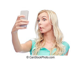 funny young woman taking selfie with smartphone -...