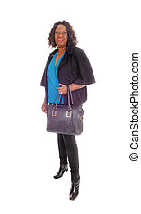 African American woman with handbag - A tall smiling African...