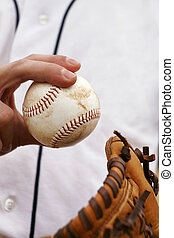 Pitcher Demonstrates His Baseball Grip - Pitcher showing how...