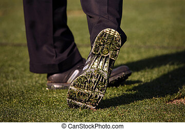 Close-up of Golfer\'s Shoe After Hitting Ball - Bottom of...