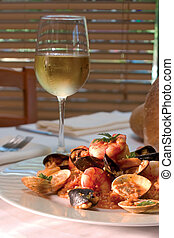 Shrimp dish and glass of white wine - Mouthwatering plate of...