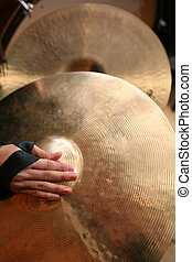 Close-up of Hand Cymbals - Hand cymbals being played in...