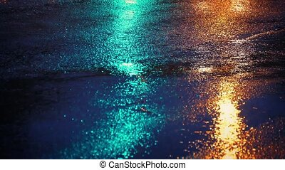 Lights From Cars And Crosswalk - Closeup of wet road surface...