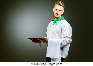 demonstrate - Portrait of a male chef cook in uniform...