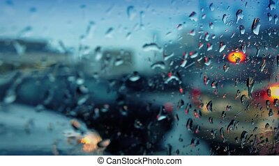 Moving In Traffic Window Raindrops - Moving past cars at...