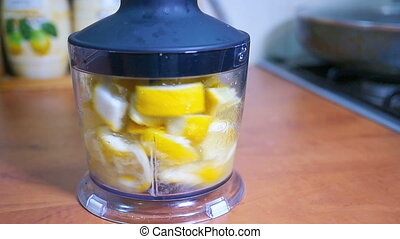 Sliced lemon poured into a blender, slow motion