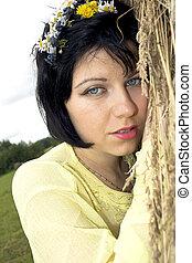 Sad pretty lady near a haystack