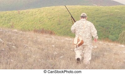 hunting the Hunter - Hunter walking in the field in search...