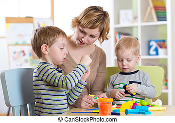 Mother and kids have a fun at home - Woman and kids have a...