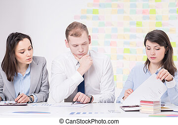 Let's think about that - Group of three businesspeople...