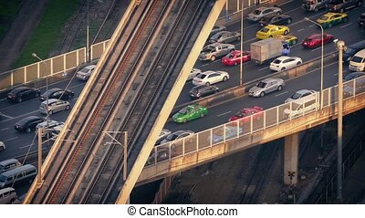 Subway Train Passes Over Cars - Mass transit system with...
