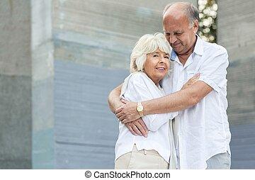 Senior man embracing his wife - Image of senior man...