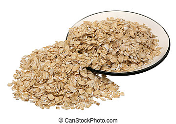 Rolled oats on a glass saucer on a white background