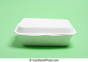 Polystyrene Food Box on green Background
