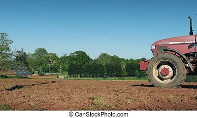 Tractor Passes By Plowing Field - Tractor pulling plow tool...