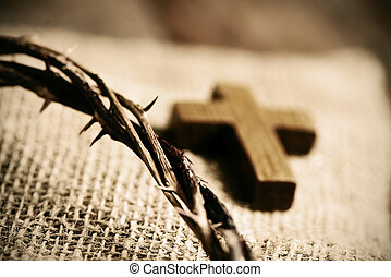 wooden cross and the crown of thorns of Jesus Christ - a...