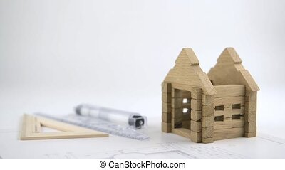 Architect builds the wooden house.