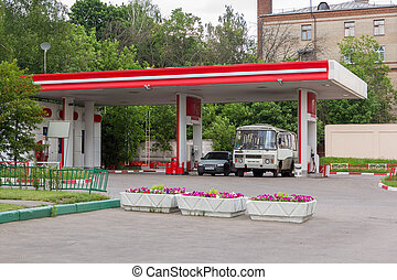 bus and car refuel at gas station - bus and car refuel at...